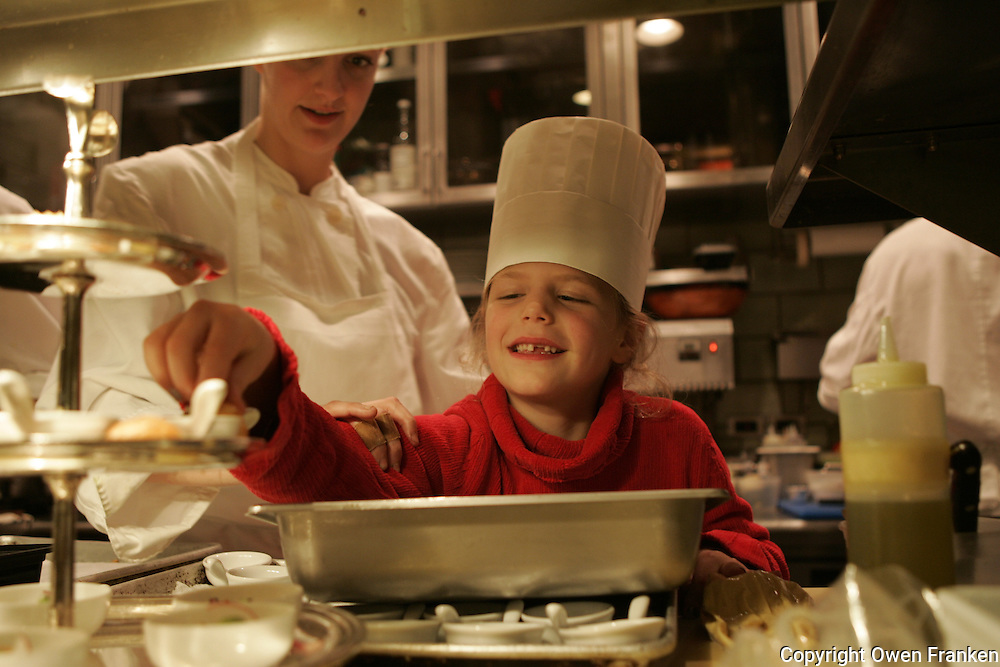 Manui helping in the kitchen at daniel, new york