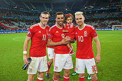 LILLE, FRANCE - Friday, July 1, 2016: Wales' Gareth Bale, Hal Robson-Kanu with his daughter and Aaron Ramsey after the 3-1 victory over Belgium during the UEFA Euro 2016 Championship Quarter-Final match at the Stade Pierre Mauroy. (Pic by David Rawcliffe/Propaganda)