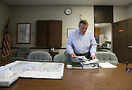 Cedar Falls Mayor Jon Crews looks over paperwork he needs to sign at City Hall in Cedar Falls, Iowa on Tuesday, July 10, 2012.