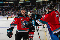 KELOWNA, BC - NOVEMBER 1: Kaedan Korczak #6 of the Kelowna Rockets celebrates a goal with fist bumps along the bench against the Prince George Cougars  at Prospera Place on November 1, 2019 in Kelowna, Canada. (Photo by Marissa Baecker/Shoot the Breeze)