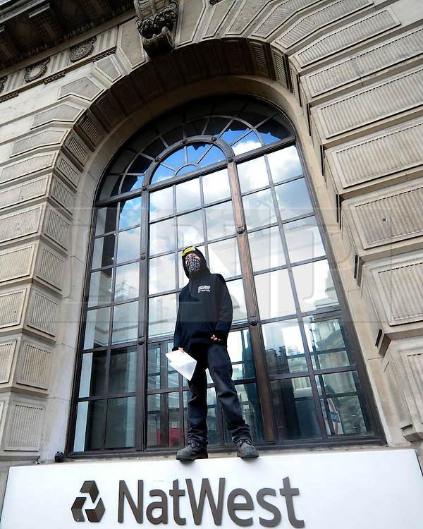 © Licensed to London News Pictures. 15/05/2012. London,Britain. A member of the Occupy London Stock Exchange group protests against the finance industry in front of a branch of NatwWest Bank in central London on May 15, 2012 . Photo credit : Thomas Campean/LNP