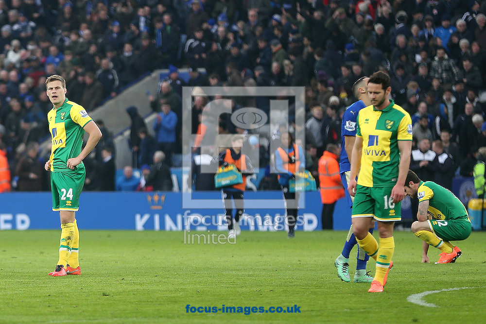 Ryan Bennett of Norwich, Robbie Brady of Norwich and Matt Jarvis of Norwich look dejected at the end of the Barclays Premier League match at the King Power Stadium, Leicester<br /> Picture by Paul Chesterton/Focus Images Ltd +44 7904 640267<br /> 27/02/2016