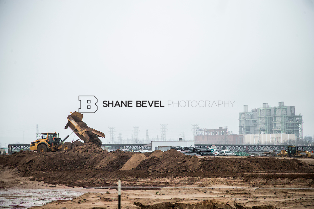 1/21/16 11:26:35 AM --  Construction work at The Gathering Place including setting and pouring the foundation of the lodge, drilling piers along riverside, and dredging the bottom of the pond.  <br /> <br /> Photo by Shane Bevel