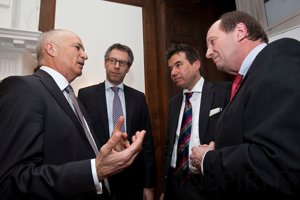 "From left:  Michael Schmid, Divisional Board Member, Commerzbank AG, Michael Hager, Member of the Cabinet of Commissioner Gunther H. Oettinger, Matthias W. Send, General Manager, HEAG Su?dhessische Energie AG (HSE), and Andreas von Scharfenberg, Chairman of the Limited Liability Company for Municipal Cooperation (GkK), after the debate meeting on ""Using sustainable energy concepts to create new business models"" on Tuesday, 24 January 2012 at the Representation of the State of Hessen to the European Union. Photo: Erik Luntang/INSPIRIT Photo..""Neue Geschäftsmodelle durch Umsetzung.zukunftsfähiger Energiekonzepte"""
