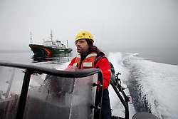 LABRADOR SEA 16JUN11 - Third engineer Iain Rogers of the UK during boat training from aboard the Greenpeace ship Esperanza in the Davis Stait off the coast of Greenland.....Photo by Jiri Rezac / Greenpeace