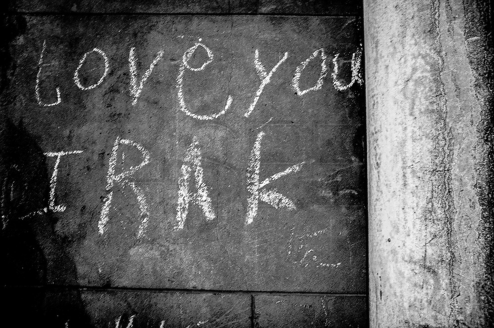"""""""Love you Irak"""" graffiti on the asylum center's wall left by one of its Irakian residents. The walls of the center are like an improvised journal of the past and present residents. FEDASIL Rixensart asylum center. Rixensart, Belgium. April 2015. I took these photographs during an international volunteer program that I liderate with an international volunteering group."""