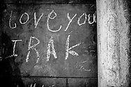 """Love you Irak"" graffiti on the asylum center's wall left by one of its Irakian residents. The walls of the center are like an improvised journal of the past and present residents. FEDASIL Rixensart asylum center. Rixensart, Belgium. April 2015. I took these photographs during an international volunteer program that I liderate with an international volunteering group."