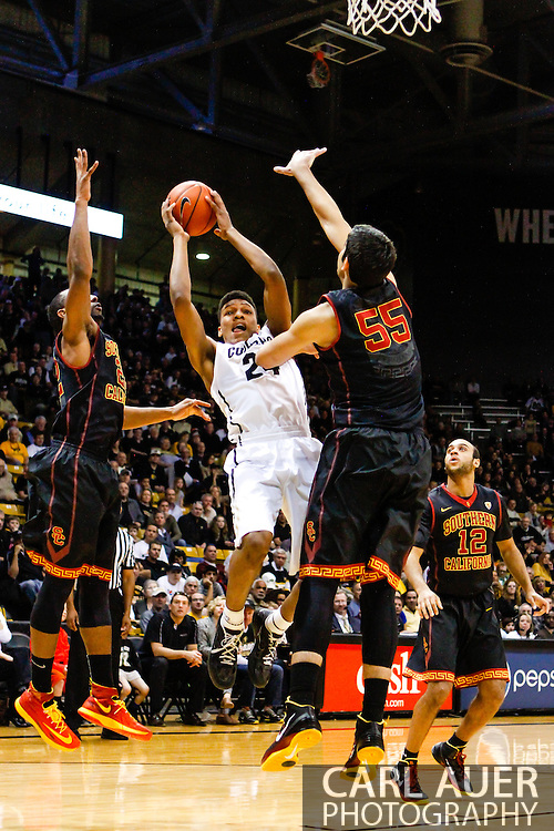 January 18th, 2014:  Colorado Buffaloes freshman guard/forward George King (24) attempts a shot in the first half of the NCAA Basketball game between the USC Trojans and the University of Colorado Buffaloes at the Coors Events Center in Boulder, Colorado