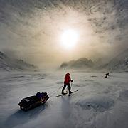 Ski traverse through Akshayuk Pass on Baffin Island in Canada's arctic.