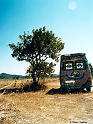 Van parked in a field with a smiley face painted on the back Ibiza 1999