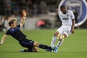 San Jose Earthquakes midfielder Florian Jungwirth (23) slides the ball away from Philadelphia Union defender Ray Gaddis (28) during an MLS soccer match won by Philadelphia 2-1, Wednesday, Sept. 25, 2019, in San Jose, Calif. (Peter Klein/Image of Sport)