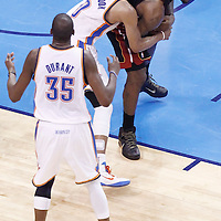 14 June 2012: Miami Heat small forward LeBron James (6) is fouled by Oklahoma City Thunder point guard Russell Westbrook (0) while Oklahoma City Thunder small forward Kevin Durant (35) reacts during the Miami Heat 100-96 victory over the Oklahoma City Thunder, in Game 2 of the 2012 NBA Finals, at the Chesapeake Energy Arena, Oklahoma City, Oklahoma, USA.