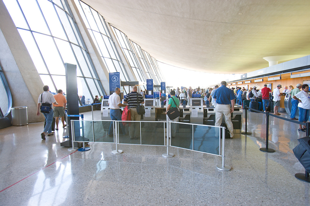 Passengers wait in the ticketing line at United Airlines at the Washington Dulles International Airport (IAD) Located in Dulles, Virginia, approximately 26 miles from downtown Washington, D.C. air transport, airport terminal, line, luggage, ticket counter, check-in