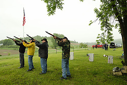 May 27, 2019 - Winnebago, NEBRASKA, USA - During morning rain showers, veterans of the Winnebago Tribe and members of American Legion Post 363 La Mere Greencrow Rice, JERRY LAMERE (Navy) far left, JACK LAMERE (Coast Guard) LEFT, CENTER, TAYLOR BASS (Army) second from right and RANDY DE CORA (Air Force) right, make up an Honor Guard to commemorate other tribal members during Memorial Day services at area cemeteries that included two family cemeteries, the Winnebago Cemetery and the St. Augustine Mission Cemetery, Monday May 27, 2019 near Winnebago, NE. (Credit Image: © Jerry Mennenga/ZUMA Wire)