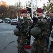 Military near Champs Elysees. COP21 in Paris. The official climate talks in Paris is on and the pressure to come up with a sustainable legally binding is high. In the aftermath of recent terrorist attacks public demonstrations have been banned during the 2 weeks of climate talks