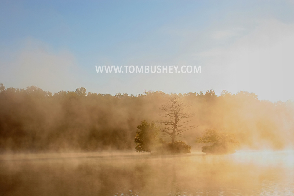 Middletown, N.Y. - The sun starts to burn the fog off the lake at Fancher Davidge Park on the morning of Sept. 29, 2006.
