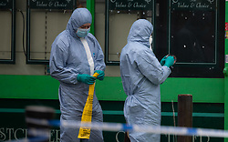 Forensics investigators collect evidence after his 30s who was stabbed outside an off licence in the early hours of Sunday February 10th on Lordship Lane, East Dulwich in London. London, February 10 2019.