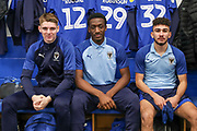 AFC Wimbledon Jack Rudoni (12), AFC Wimbledon attacker Zach Robinson (29) and AFC Wimbledon Husuyin Biler (32) in the changing room during the EFL Sky Bet League 1 match between AFC Wimbledon and Doncaster Rovers at the Cherry Red Records Stadium, Kingston, England on 14 December 2019.