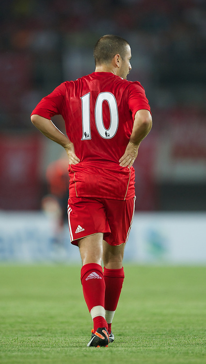 GUANGZHOU, CHINA - Wednesday, July 13, 2011: Liverpool's number ten Joe Coe in action against Guangdong Sunray Cave during the first pre-season friendly on day three of the club's Asia Tour at the Tianhe Stadium. (Photo by David Rawcliffe/Propaganda)