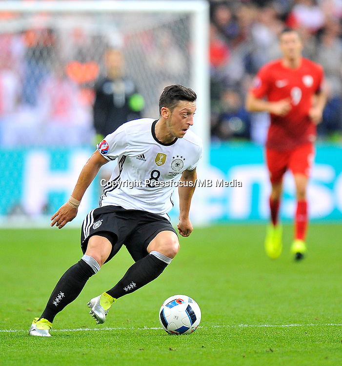 2016.06.16 Saint-Denis<br /> Pilka nozna Euro 2016<br /> mecz grupy C Polska - Niemcy<br /> N/z Mesut Ozil<br /> Foto Norbert Barczyk / PressFocus<br /> <br /> 2016.06.16 Saint-Denis<br /> Football UEFA Euro 2016 group C game between Poland and Germany<br /> Mesut Ozil<br /> Credit: Norbert Barczyk / PressFocus