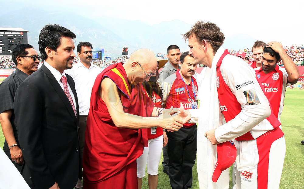 His Holiness Dalai Lama meets Kings XI Punjab captain Adam Gilchrist during match 67 of the Indian Premier League ( IPL ) Season 4 between the Kings XI Punjab and the Deccan Chargers held at the The HPCA Stadium in Dharamsala, Himachal Pradesh, India on the 21st May 2011..Photo by Money Sharma/BCCI/SPORTZPICS