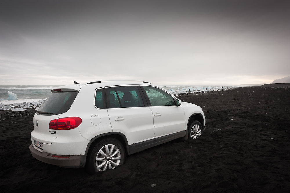 Hire car bogged down in soft sand, Breithamerkursandur, Iceland