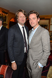 Left to right, TOM HOOPER and ALEXANDER GILKES at a Thanksgiving dinner hosted by Alexander Gilkes of Paddle8 at Annabel's, 44 Berkeley Square, London on 23rd November 2016.