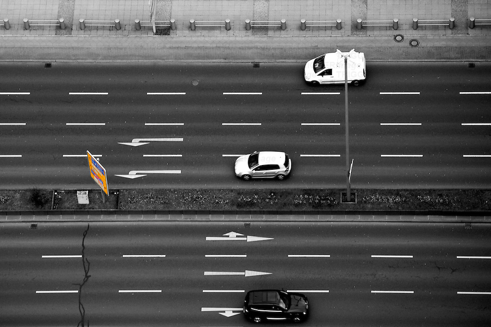 The plan view and aerial view of a multiple lane road with traffic.