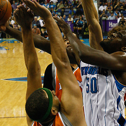 April 8, 2011; New Orleans, LA, USA; New Orleans Hornets center Emeka Okafor (50) is defended by Phoenix Suns small forward Jared Dudley (3) during the second quarter at the New Orleans Arena.  Mandatory Credit: Derick E. Hingle
