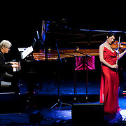 "April 9, 2011 - Manhattan, NY : Ryuichi Sakamoto, left, and Anna Akiko Meyers perform during the Japan Society's 12-hour-long special ""Concert For Japan"" charity event on Saturday.  (This was taken during the 6-7:20pm Gala Block)... CREDIT: Karsten Moran for The New York Times."