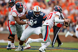 Auburn Tigers defensive lineman Tyrone Truesdell (94) attempts to tackle Mississippi Rebels quarterback Shea Patterson (20) during an NCAA football game, Saturday, October 7, 2017, in Auburn, AL. Auburn won 44-23. (Paul Abell via Abell Images for Chick-fil-A Peach Bowl)