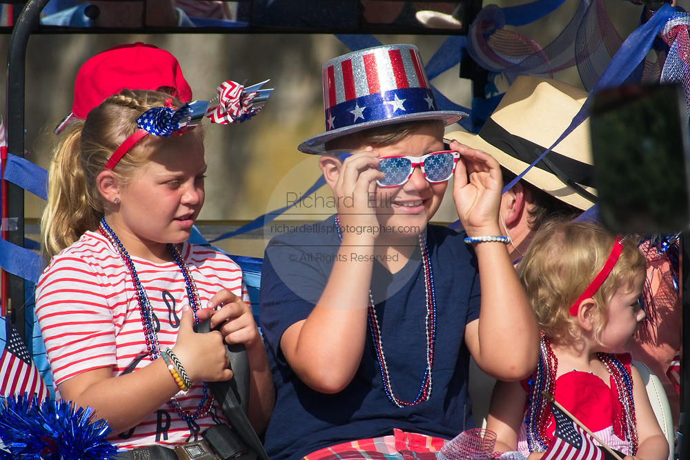 A group of young children dressed in patriotic colors during the annual Sullivan's Island Independence Day parade July 4, 2017 in Sullivan's Island, South Carolina. The tiny affluent sea island hosts a bicycle and golf cart parade through the historic village.