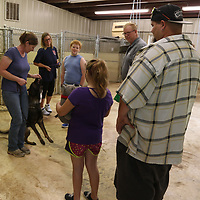 Dog trainer Candace Baird shows attendees of Tupelo Smal Animal Hospital's open house some tricks with one of her dogs, Morgan