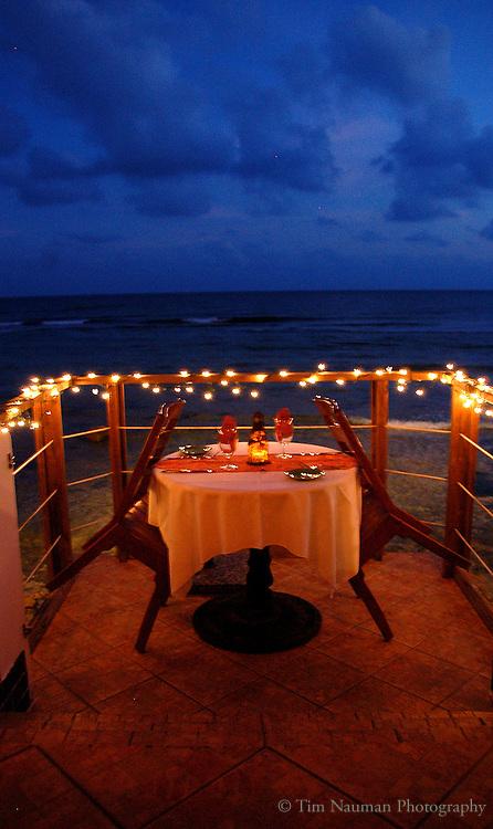 romantic dinner table on the beach