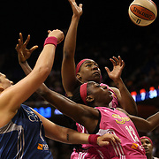 Janel McCarville, (left), Minnesota Lynx, challenges for a rebound with Kelsey Bone and Chiney Ogwumike, (right), Connecticut Sun, during the Connecticut Sun Vs Minnesota Lynx, WNBA regular season game at Mohegan Sun Arena, Uncasville, Connecticut, USA. 27th July 2014. Photo Tim Clayton