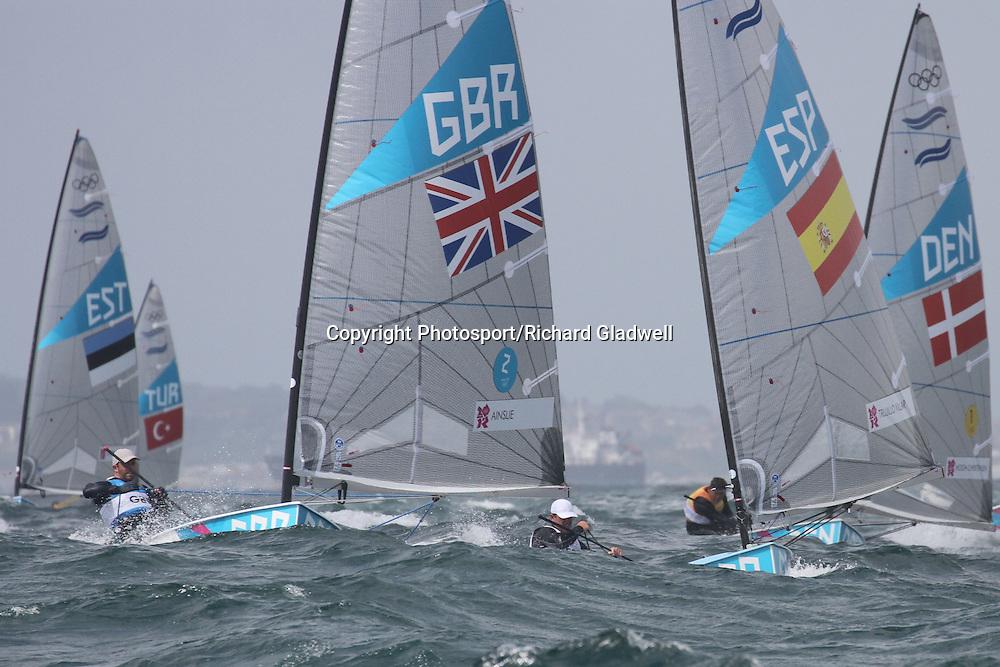 August 2, 2012 - Weymouth, England - Ben Ainslie (GBR)  leads in the Finn class