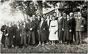 priest with congregation group portrait outdoors early 1900s France