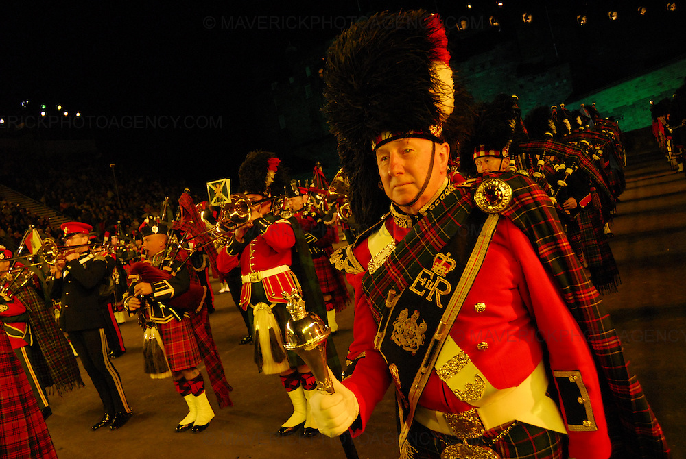 Dancers, musicians,stunt men and women put on a colourful show at the dress rehersal of this years 58th Edinburgh Military Tattoo at Edinburgh Castle Esplanade. The event is the largest gathering of military musicians in the UK with participants from as far afield as Africa, America and Asia.  This years showpiece military extravaganza is set to pay tribute to the Diamond Wedding Anniverary of HM The Queen and HRH Prince Phillip. Pictured the Massed Pipes and Drums..