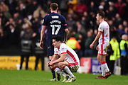 Milton Keynes Dons defender George Williams (2) on his haunches, dejected during the EFL Sky Bet League 1 match between Milton Keynes Dons and Portsmouth at stadium:mk, Milton Keynes, England on 10 February 2018. Picture by Dennis Goodwin.
