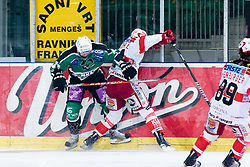 Johannes Reichel (EC KAC, #14) vs Tomi Mustonen (HDD Tilia Olimpija, #21) during ice-hockey match between HDD Tilia Olimpija and EC KAC in 32nd Round of EBEL league, on December 30, 2010 at Hala Tivoli, Ljubljana, Slovenia. (Photo By Matic Klansek Velej / Sportida.com)
