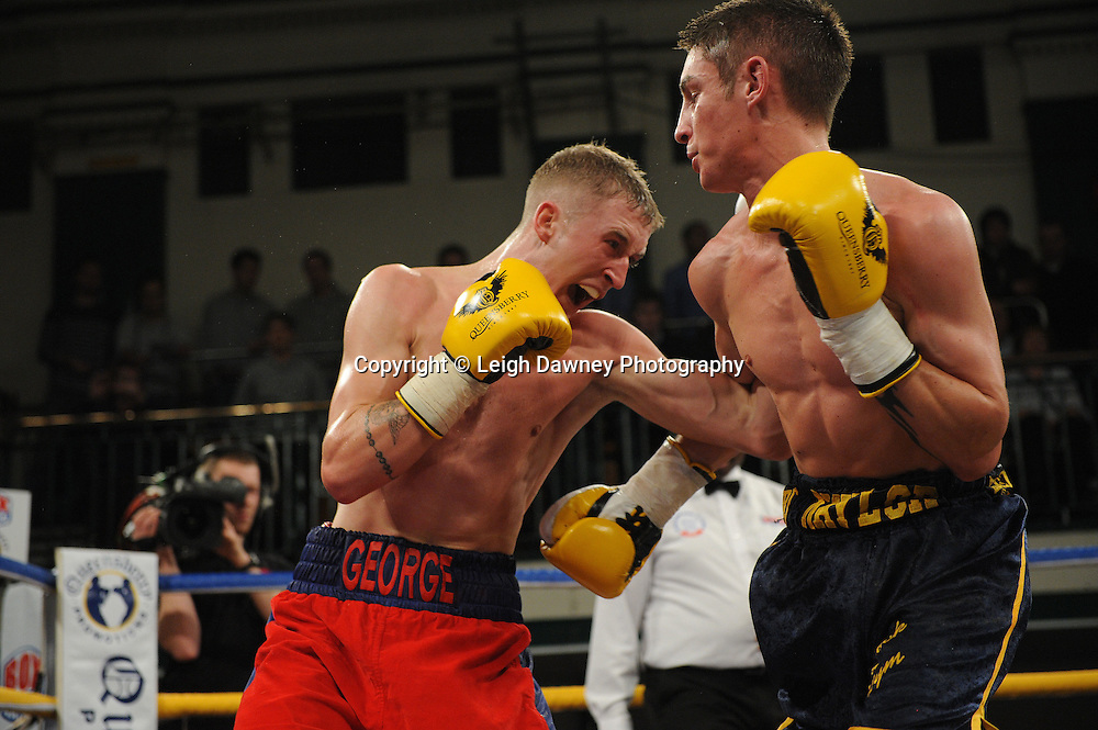 George Jupp (red shorts) defeats Dan Naylor in a Featherweight contest at York Hall, Bethnal Green, London on Friday 13th January 2012. Queensbury Promotions © Leigh Dawney 2012