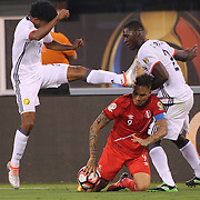EAST RUTHERFORD, NEW JERSEY - JUNE 17: Jose Paolo Guerrero #9 of Peru is fouled by Juan Cuadrado #11 of Colombia and Cristian Zapata #2 of Colombia  during the Colombia Vs Peru Quarterfinal match of the Copa America Centenario USA 2016 Tournament at MetLife Stadium on June 17, 2016 in East Rutherford, New Jersey. (Photo by Tim Clayton/Corbis via Getty Images)