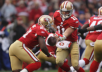 Alex Smith #11 of the San Francisco 49ers hands off to Frank Gore #21 against the New York Giants during the NFC championship game at Candlestick Park in San Francisco, California, USA 22 Jan 2012..The Giants defeated the 49ers 20-17. (Photo by Jed Jacobsohn)....