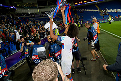 CARDIFF, WALES - Thursday, June 1, 2017: Olympique Lyonnais' Wendie Renard with the trophy as her side celebrate winning the UEFA Champions League during the UEFA Women's Champions League Final between Olympique Lyonnais and Paris Saint-Germain FC at the Cardiff City Stadium. (Pic by David Rawcliffe/Propaganda)