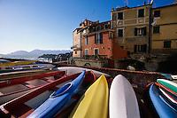 2000, Tellaro, Italy --- Kayaks Along Poets' Gulf --- Image by © Owen Franken/CORBIS