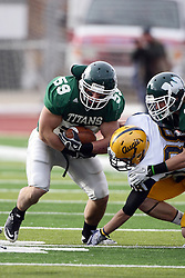 12 November 2011:  Mike Leftakes intercepts a ball destined for a Viking reciever during an NCAA division 3 football game between the Augustana Vikings and the Illinois Wesleyan Titans in Tucci Stadium on Wilder Field, Bloomington IL