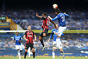 Everton midfielder Andre Gomes (21) beats Bournemouth forward Callum Wilson (13) in the air during the Premier League match between Everton and Bournemouth at Goodison Park, Liverpool, England on 26 July 2020.
