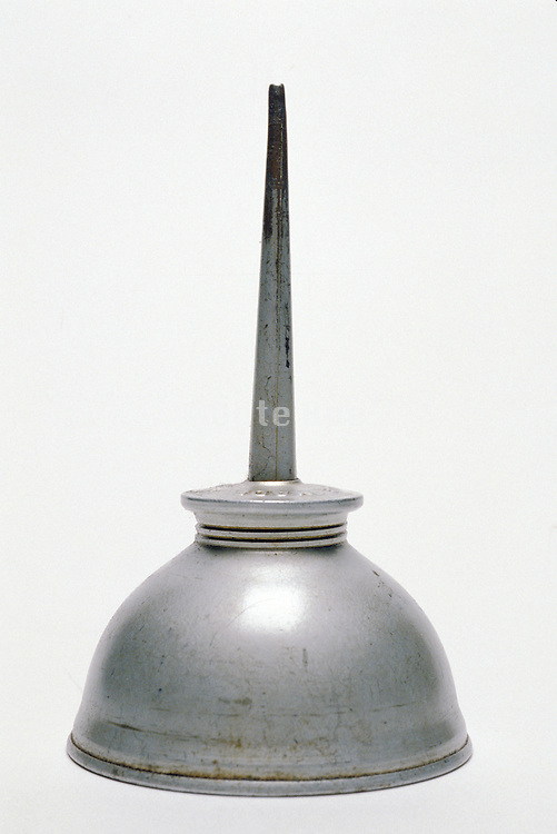 still life of antique oil can