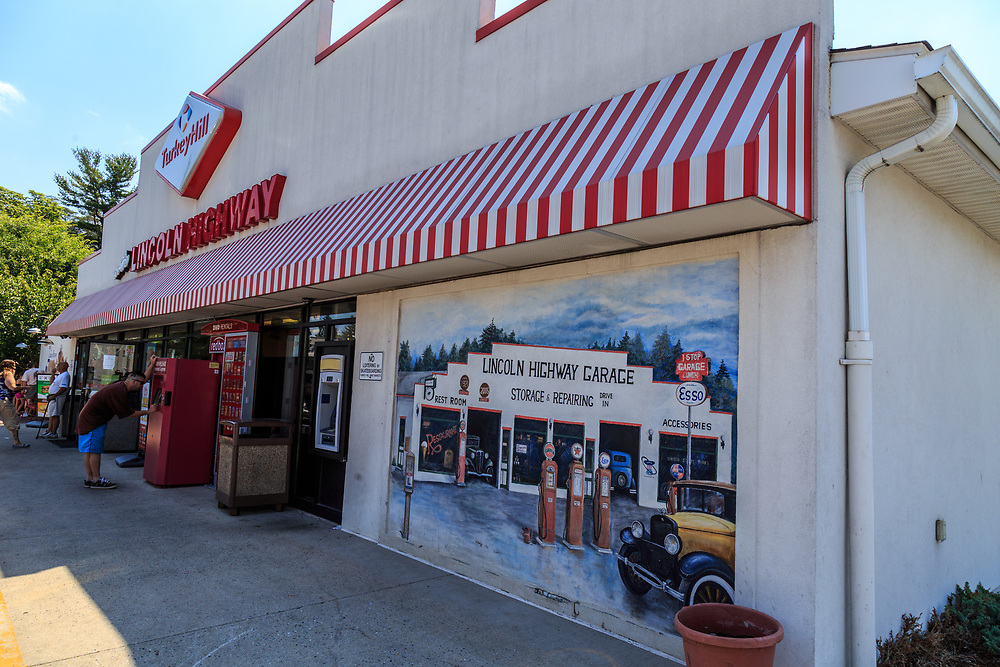 York, PA – June 25, 2016: The Lincoln Highway Garage, originally constructed in 1921, offered the first drive-in service station between Philadelphia and Pittsburgh, has been immortalized by a Turkey Hill Market with murals and architectural features.