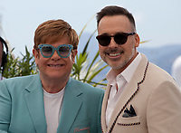Sir Elton John and David Furnish at Rocketman film photo call at the 72nd Cannes Film Festival, Thursday 16th May 2019, Cannes, France. Photo credit: Doreen Kennedy